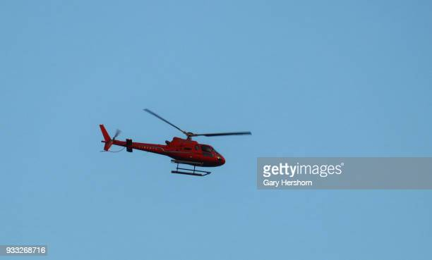 A helicopter owned by Liberty Helicopters flies over the Hudson River at sunset in New York City on March 15 2018 as seen from Hoboken New Jersey