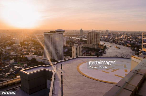 helicopter parking and sky background - helipad stock photos and pictures