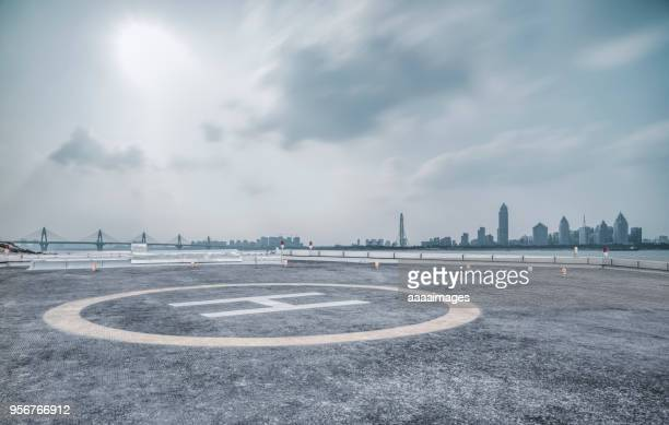 helicopter parking front of nanchang city - helipad stock photos and pictures