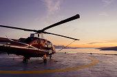 Helicopter parking landing on offshore platform, Helicopter transfer passenger