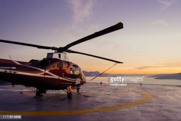 helicopter parking landing on offshore platform, helicopter transfer passenger - helicopter photos stock pictures, royalty-free photos & images