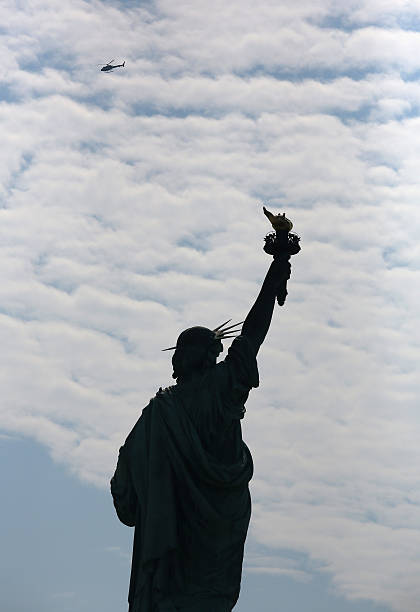 Jeh Johnson Attends Naturalization Ceremony At New York's Ellis Island