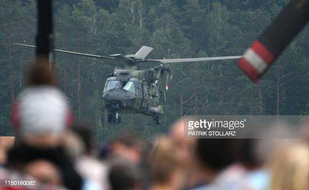 Helicopter performs during an air show as part of the festivities to mark the Day of the German Armed Forces on June 15, 2019 at the air base in...