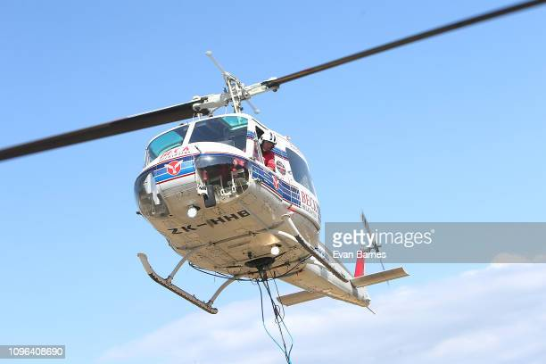 Helicopter Pilot David Beck from Beck Helicopters takes off back to the fire as the Forest Fires Continue To Burn Across Tasman District Near Nelson...