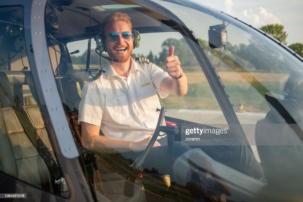 Helicopter pilot giving thumbs up : Stock Photo