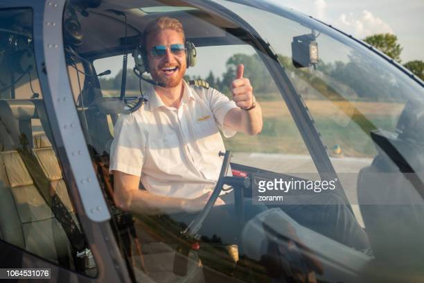 helicopter pilot giving thumbs up - helicopter photos stock pictures, royalty-free photos & images