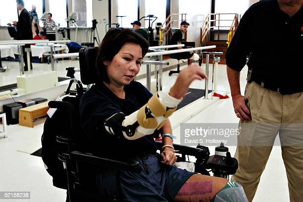 WASHINGTON JANUARY 7 Helicopter pilot Major Ladda Tammy Duckworth of the Illinois National Guard in Chicago IL demonstrates the improved use of her...