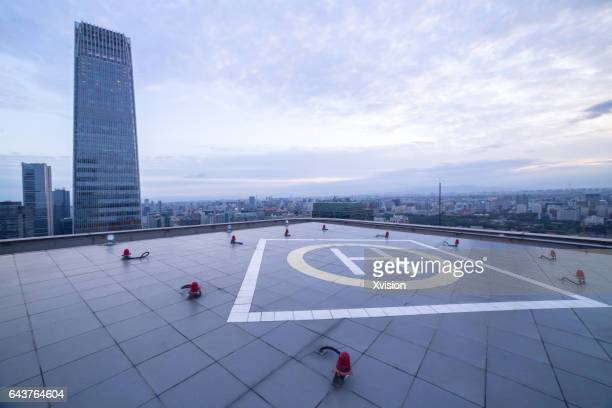 helicopter platform with modern skyscraper as background in beijing cbd area - helipad stock photos and pictures