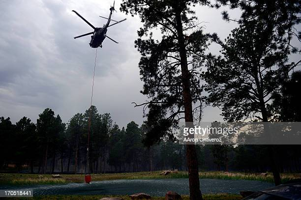A helicopter prepares to fill to fight the Black Forest fire burns east of Colorado Springs