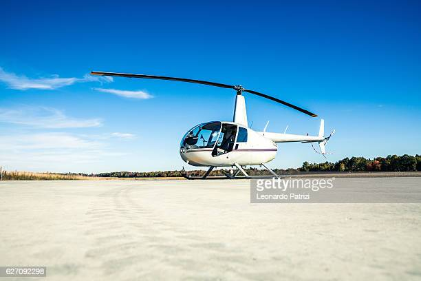 helicopter ready for departure at heliport - helicopter stock pictures, royalty-free photos & images