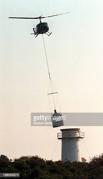 Helicopter removes the lantern room from Cape Poge Lighthouse on Chappaquiddick Island and delivered it to Falmouth Able Rigging and Transfer Co of E...