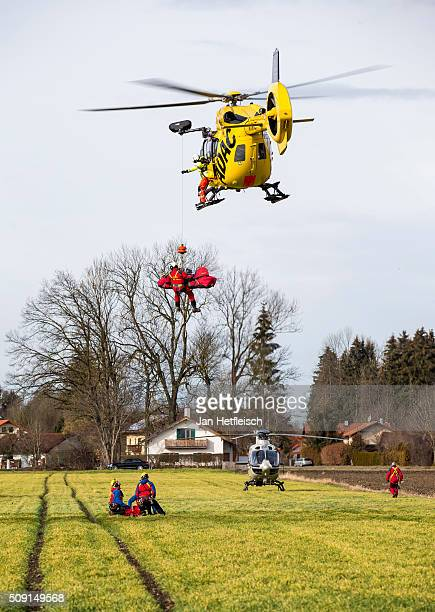 A helicopter rescues a casualty from the area after two trains collided headon several hours before in Bavaria on February 9 2016 near Bad Aibling...