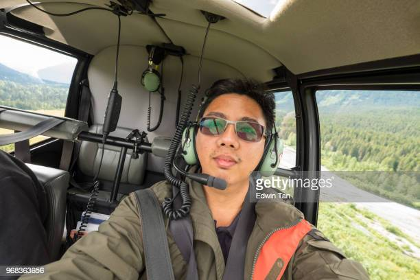 helicopter ride to glacier snow mountain in alaska , usa - inside helicopter stock pictures, royalty-free photos & images