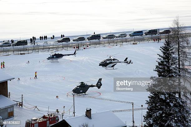 A helicopter right prepares to land on the helipad at the InterContinental Hotel Davos operated by InterContinental Hotels Group Plc ahead of the...