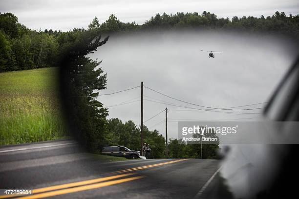 Helicopter searches for two escaped convicts on June 15, 2015 outside Dannemora, New York. The two convicted murderers escaped from Clinton...