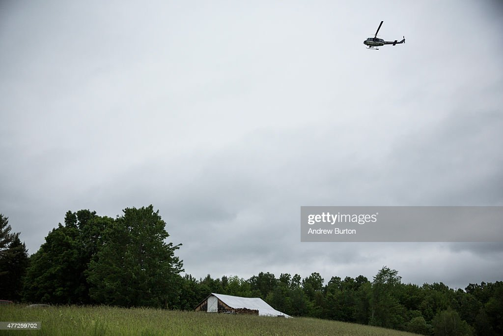 A helicopter searches for two escaped convicts on June 15