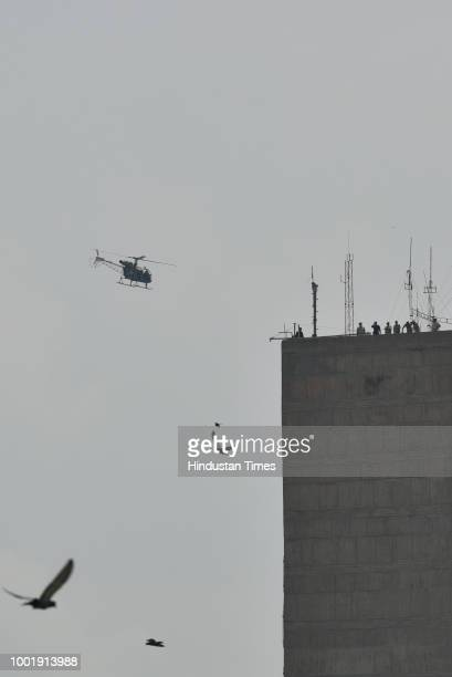 A helicopter seen hovering in the skies of National Capital ahead of the Independence Day Celebrations and on the occasion of monsoon session of the...