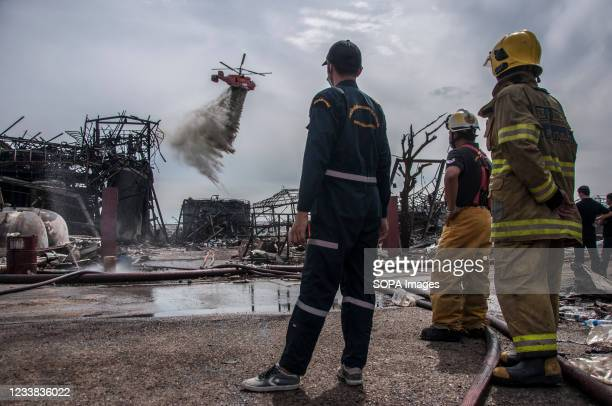 Helicopter seen spraying chemical powder to extinguish the fire caused by an explosion at a fire-ravaged Ming Dih Chemical factory in Bang Phli...