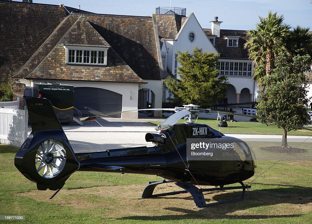 A helicopter sits outside the mansion owned by Kim Dotcom, founder of Megaupload.com, in Coatesville, near Auckland, New Zealand, on Sunday, Jan. 20, 2013. Dotcom, marking one year since his Megaupload.com website was shut down by the U.S. Department of Justice and his home raided by New Zealand tactical squad officers in helicopters, unveiled his new website Mega, a successor file-storage and sharing site, saying innovation won't be stopped. Photographer: Brendon O'Hagan/Bloomberg via Getty Images