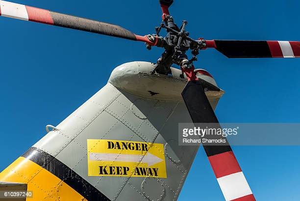 helicopter tail rotor - danger - helicopter rotors stock photos and pictures
