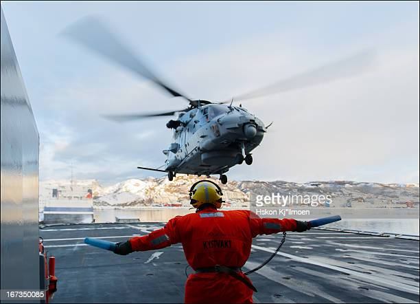 CONTENT] NH90 helicopter take off from Coast Guard vessel Svalbard