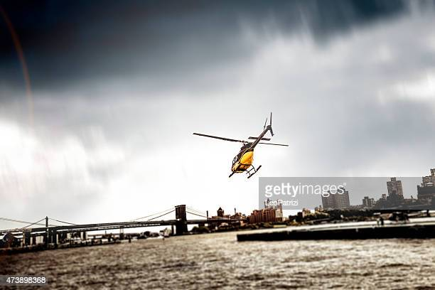 helicopter take off from manhattan heliport in new york - helipad stock photos and pictures