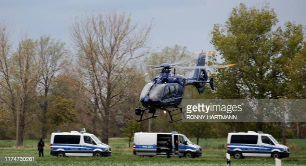 A helicopter takes off as police secures the area between Wiedersdorf and Landsberg near Halle eastern Germany where shots were fired on October 9...
