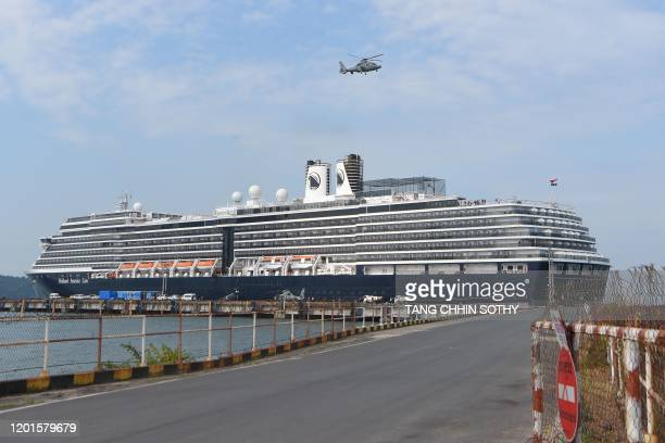 A helicopter takes off next to the Westerdam cruise ship in Sihanoukville on February 18 as authorities checked if any passengers that remained could...