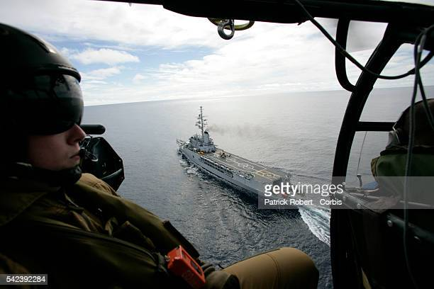 A helicopter takes off on a mission from the flight deck of the Jeanne d'Arc helicopter carrier commandeered to lead relief operations in the wake of...