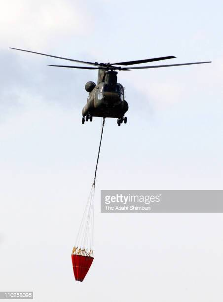 A helicopter takes off to drop water to cool down the reactors of the Fukushima Daiichi Nuclear Plant at Japan Air SelfDefense Force Kasuminome Air...