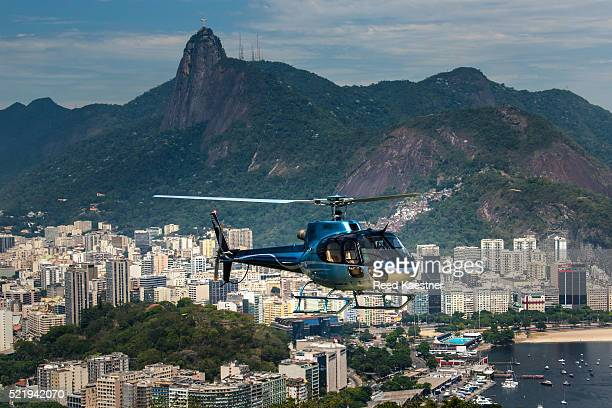 A helicopter takes tourists for a view of Rio de Janeiro