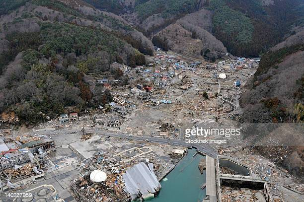 a helicopter team surveys the tsunami and earthquake damage over japan. - natural disaster stock pictures, royalty-free photos & images