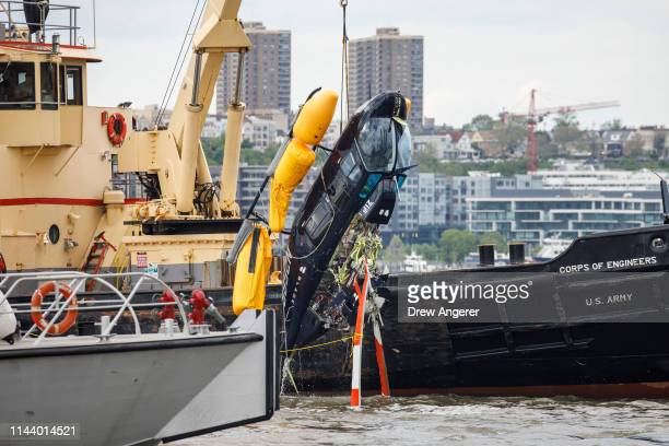 A helicopter that crashed in the Hudson River is pulled out of the water May 15 2019 in New York City The pilot survived the incident The pilot was...