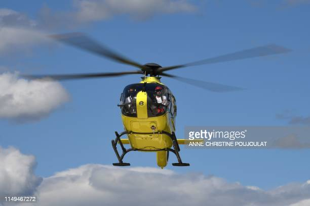 A helicopter transporting Team Ineos rider Great Britain's Christopher Froome to another hospital takes off from the roof of the Centre Hospitalier...