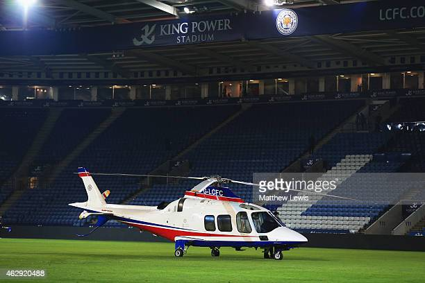 A helicopter used by the Leicester City owners lands on the pitch after the Barclays Premier League match between Leicester City and Crystal Palace...