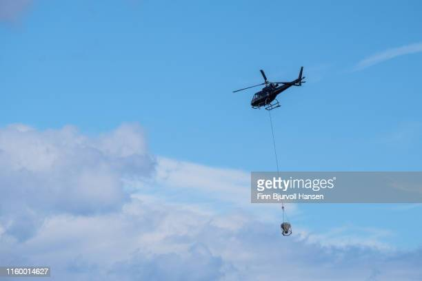 helicopter used for transporting cement during construction work on island - finn bjurvoll stock pictures, royalty-free photos & images
