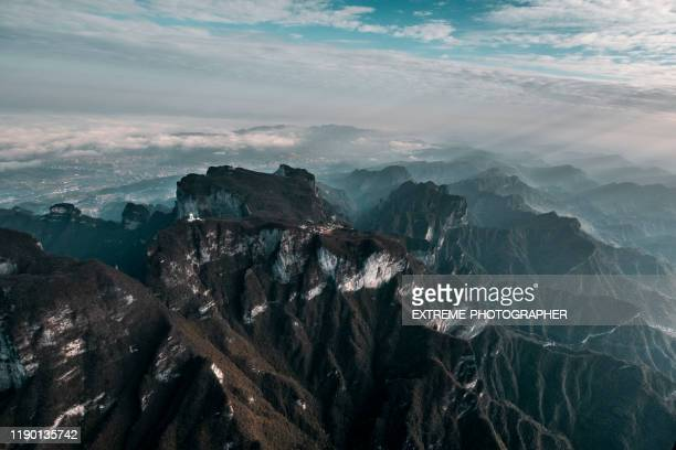 helicopter view of a serpentine road near zhangjiajie (张家界), tianmen shan(天门山) - tianmen stock pictures, royalty-free photos & images
