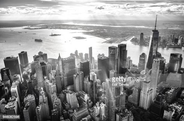 helicopter view of downtown manhattan island, new york, at sunset - black and white stock pictures, royalty-free photos & images