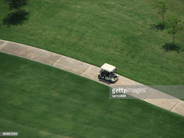 helicopter view of golf cart - green golf course stock pictures, royalty-free photos & images