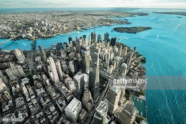 helicopter view of manhattan island - lower manhattan stock photos and pictures