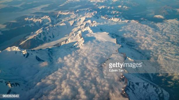 helicopter view on alaska snow mountain - helicopter photos stock pictures, royalty-free photos & images