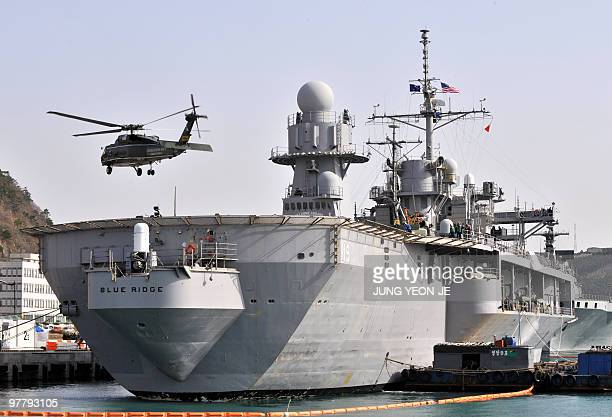 A helicopter whirls off the command ship USS Blue Ridge from the US Navy's Seventh Fleet during an annual joint military exercise with South Korea at...