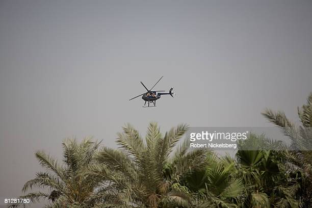 A helicopter with a 4man crew operated by Blackwater Security Company flies over on May 7 2008 in Baghdad Iraq The Moyock NC based company provides...