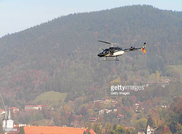 Helicopter with a film camera crew circles above lake Tegernsee after a canoe carrying three people capsized during the shooting of a made for TV...