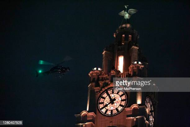 Helicopter with a film crew aboard circles the Liver Building during filming of The Batman movie on October 15, 2020 in Liverpool, United Kingdom....