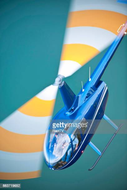 a helicopter with blurred motion blades. - helicopter rotors stock photos and pictures