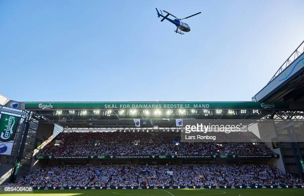 A helicopter with Thomas Delaney carrying the champions trophy landing on the pitch after the Danish Alka Superliga match between FC Copenhagen and...