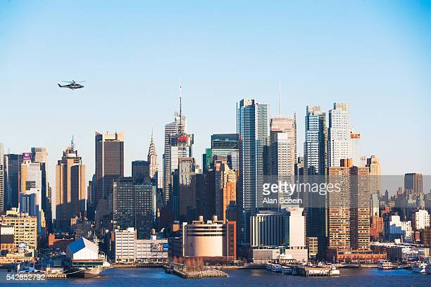 helicopter,empire state building and west side of manhattan