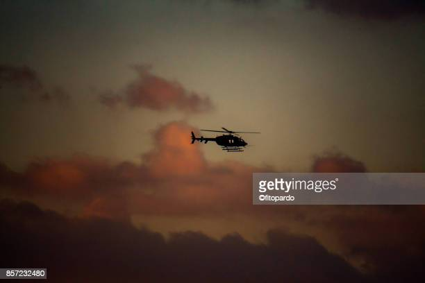 helicopters and sunset - helicopter rotors stock photos and pictures