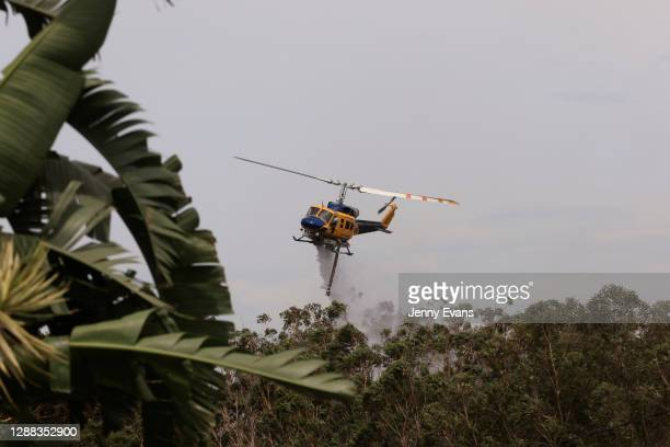 Helicopters are seen water bombing an out of control bushfire at Northmead on November 29, 2020 in Sydney, Australia. The Bureau of Meteorology has...